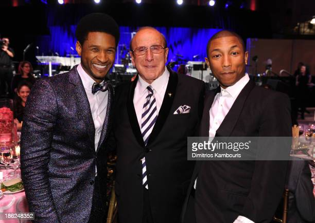 Usher Clive Davis and Pharrell Williams attend Gabrielle's Angel Foundation Hosts Angel Ball 2013 at Cipriani Wall Street on October 29 2013 in New...