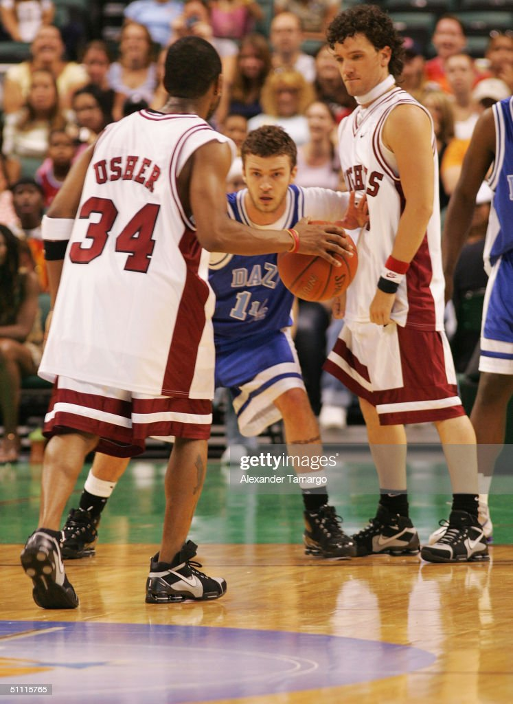 Usher (L) Justin Timberlake, (C) and J.C. Chasez the NSYNC Challenge For The Children Celebrity Basketball Game at Office Depot Center in Sunrise, Florida on July 25, 2004.