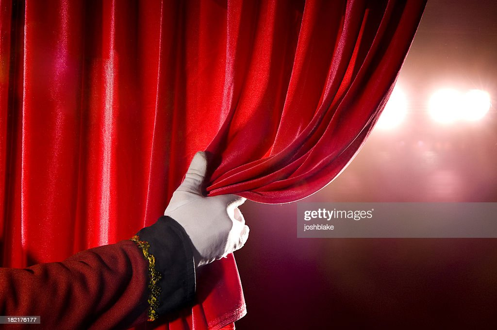 Usher Opening Red Theater Curtain, With Spotlights : Stock Photo