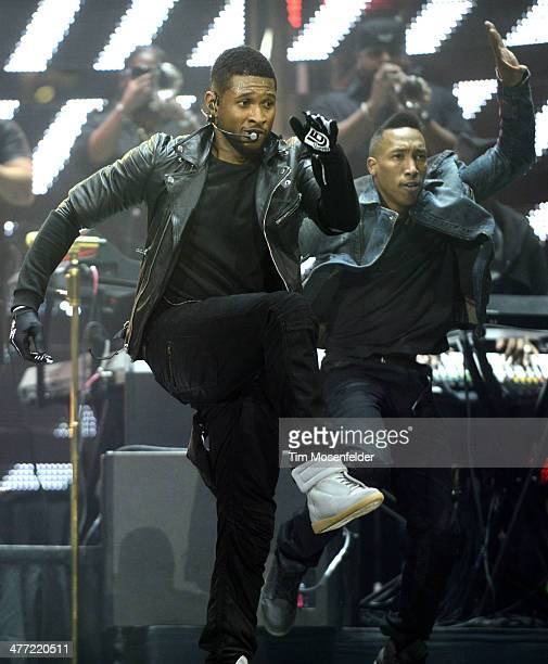 Usher performs as part of the Houston Livestock Show and Rodeo at Reliant Stadium on March 7, 2014 in Houston, Texas.