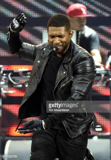 Usher performs as part of the Houston Livestock Show and Rodeo at Reliant Stadium on March 7 2014 in Houston Texas