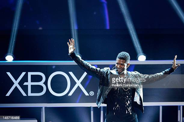 Usher performs as the game Dance Central 3 is introduced during the Microsoft Xbox press conference at the Electronic Entertainment Expo at the Galen...