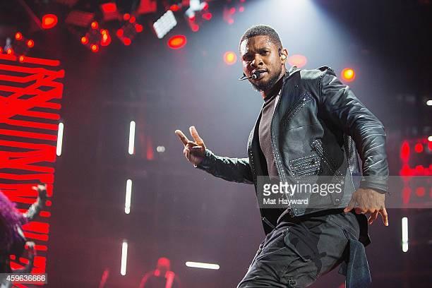 Usher performs on stage at KeyArena on November 26, 2014 in Seattle, Washington.