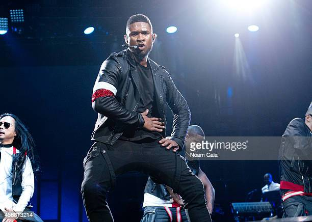 Usher performs onstage during his 'The UR Experience' tour at Madison Square Garden on November 7 2014 in New York City