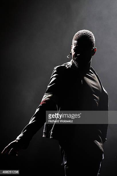 """Usher performs onstage during his """"The UR Experience"""" tour opener at Bell Centre on November 1, 2014 in Montreal, Canada."""
