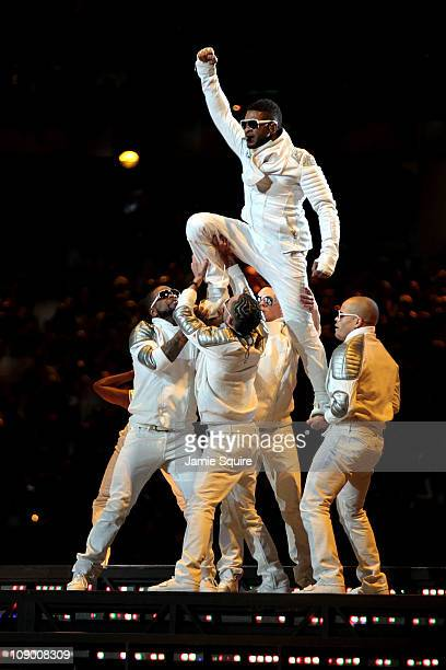 Usher performs with the Black Eyed Peas perform during the Bridgestone Super Bowl XLV Halftime Show at Cowboys Stadium on February 6 2011 in...