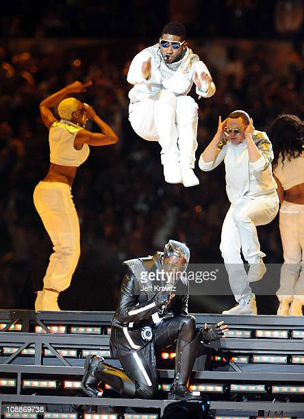 Usher performs with will.i.am of The Black Eyed Peas during the Bridgestone Super Bowl XLV Halftime Show at Dallas Cowboys Stadium on February 6,...