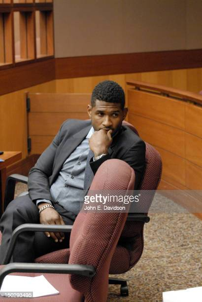 Usher Raymond attends a hearing to discuss child custody between Usher Raymond and Tameka Foster at Fulton County State Court on August 14 2012 in...
