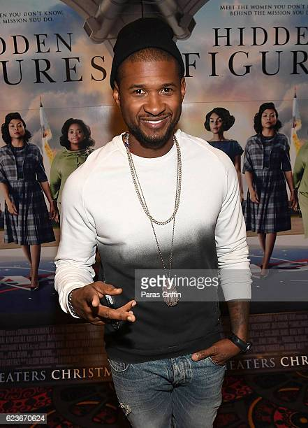 Usher Raymond attends Hidden Figures advanced screening hosted by Janelle Monae Pharrell Williams at Regal Cinemas Atlantic Station Stadium 16 on...