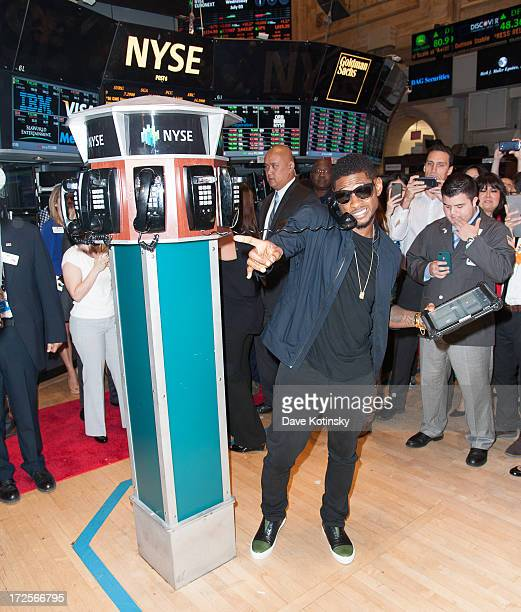 Usher rings the NYSE closing bell at the New York Stock Exchange on July 3 2013 in New York City