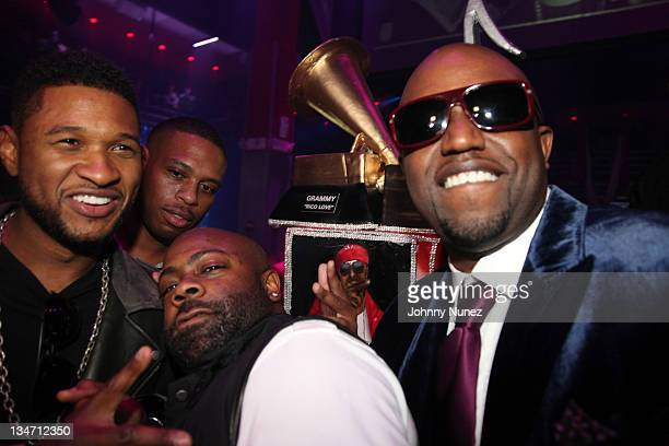 Usher Shawn Holiday Breyon Prescott and Rico Love celebrate Rico Love's birthday on December 2 2011 at Vic and Angelo's in Miami Beach Florida