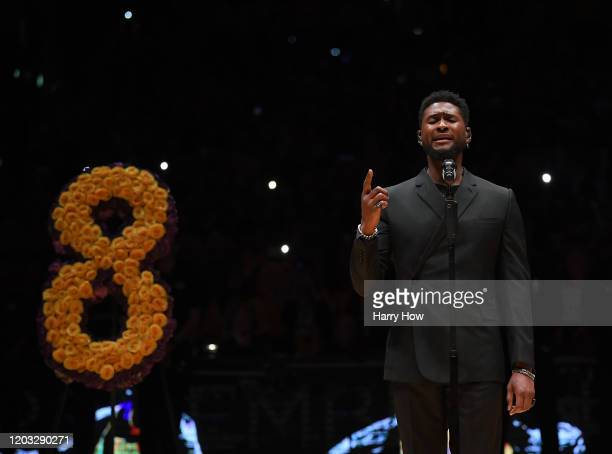 Usher sings Amazing Grace during the Los Angeles Lakers pregame ceremony to honor Kobe Bryant before the game against the Portland Trail Blazers at...