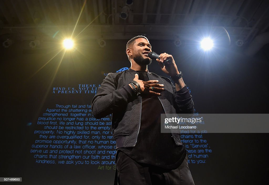 Usher speaks onstage at Art For Social Justice, Usher Raymond IV, Daniel Arhsam and TIDAL debut Chains at Urban Zen on January 29, 2016 in New York City.
