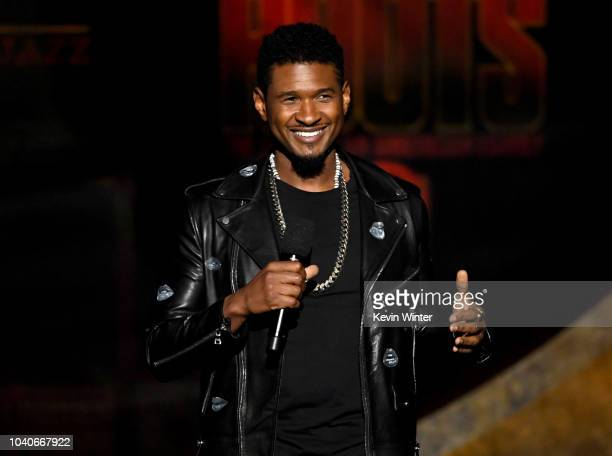 Usher speaks onstage at Q85 A Musical Celebration for Quincy Jones at the Microsoft Theatre on September 25 2018 in Los Angeles California