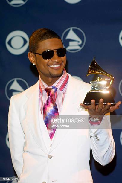 Usher with his award for Best Male RB Vocal Performance in the Press Room backstage at the 45th Annual Grammy Awards Photo by Steve Azzara/Corbis...