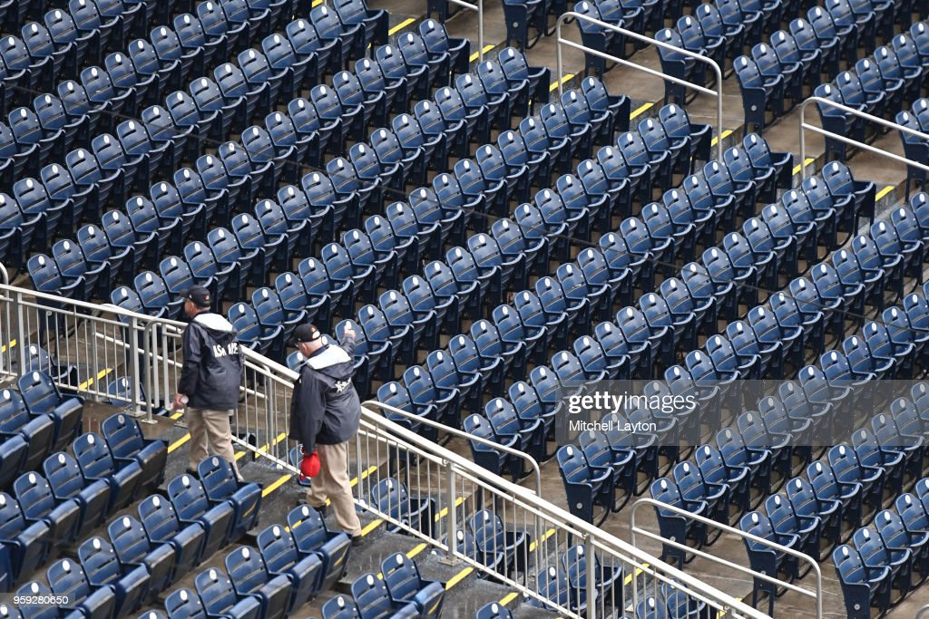 Ushers head home after the Washington Nationals cancelled tonights game because of rain against the New York Yankees at Nationals Park on May 16, 2018 in Washington, DC.