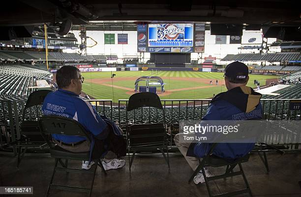 Ushers wait for fans to enter the stadium for the game between the Milwaukee Brewers and Colorado Rockies on opening day at Miller Park on April 1...