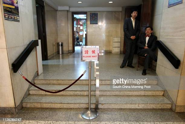Ushers waiting at the lobby of the theatre before the show opens Sunbeam Theatre where Feng Sheng Hui Theatre preforms their last show 'the Lion's...