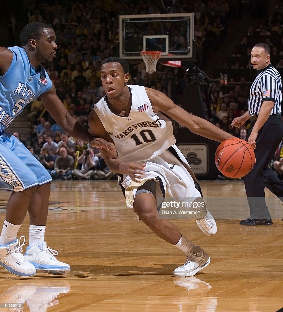 Ushmael Smith #10 of the Wake Forest Demon Deacons tries to dribble the ball past Ty Lawson #5 of the North Carolina Tar Heels at the LJVM Coliseum January 11, 2009 in Winston-Salem, North Carolina. The Demon Deacons defeated the Tar Heels 92-89.