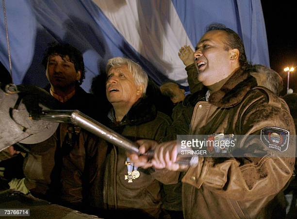 Argentina's Malvinas war veterans raise a new national flag in Ushuaia 2 April 2007 during a ceremony to commemorate the 25th anniversary of the...