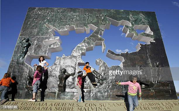 Kids play 01 April 2007 in Ushuaia Argentina at the monument in homage to the fallen in combat during the Falklands war between Argentina and the...