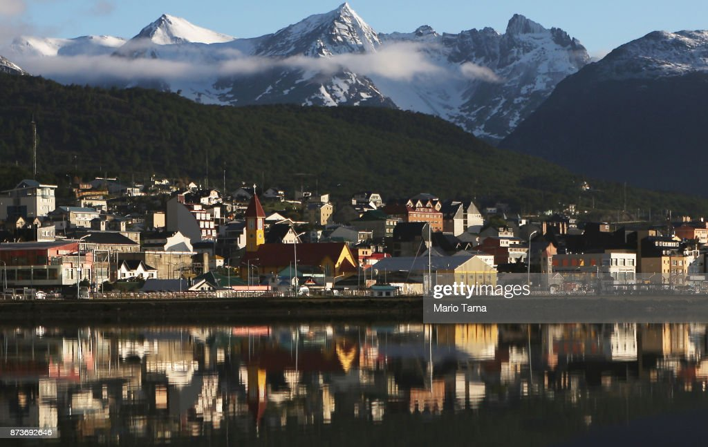 Ushuaia is reflected near the main docks on November 5, 2017 in Ushuaia, Argentina. Ushuaia is situated along the southern edge of Tierra del Fuego, in the Patagonia region, and is commonly known as the 'southernmost city in the world'. The city's main fresh water supply comes from the retreating Martial Glacier, which may be at risk of disappearing. In a 2015 report, warming temperatures led to the loss of 20 percent of the mass and surface of glaciers in Argentina over the previous 50 years, according to Argentina's Institute of Nivology, Glaciology and Environmental Sciences (IANIGLIA). Ushuaia and surrounding Tierra del Fuego face other environmental challenges including a population boom leading to housing challenges following an incentivized program attracting workers from around Argentina. Population in the region increased 11-fold between 1970 and 2015 to around 150,000. An influx of cruise ship tourists and crew, many on their way to Antarctica, has also led to increased waste and pollution in the area sometimes referred to as 'the end of the world'.