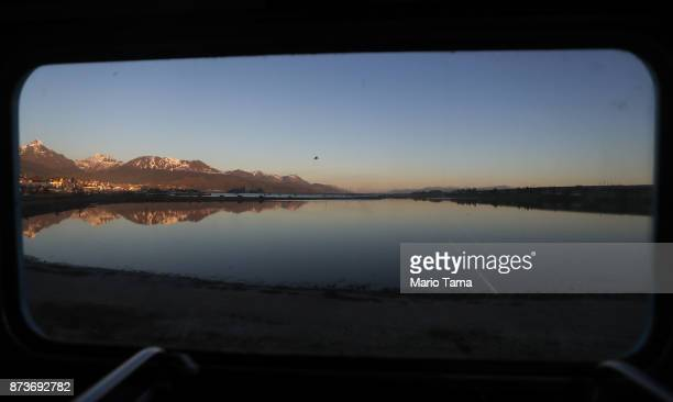 Ushuaia is viewed from the window of a vintage London Routemaster bus used for tourist tours on November 4 2017 in Ushuaia Argentina Ushuaia is...