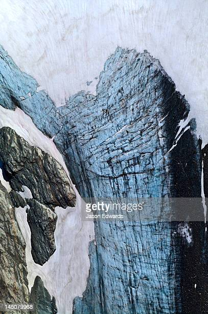 a mosaic of fracture lines on the surface of a weathered glacier. - plate tectonics stock photos and pictures