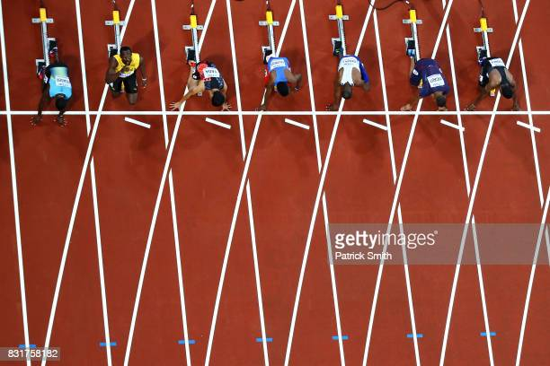 Usian Bolt of Jamaica looks to the sky as he and fellow competitors take their marks in the mens 100m heats during day one of the 16th IAAF World...