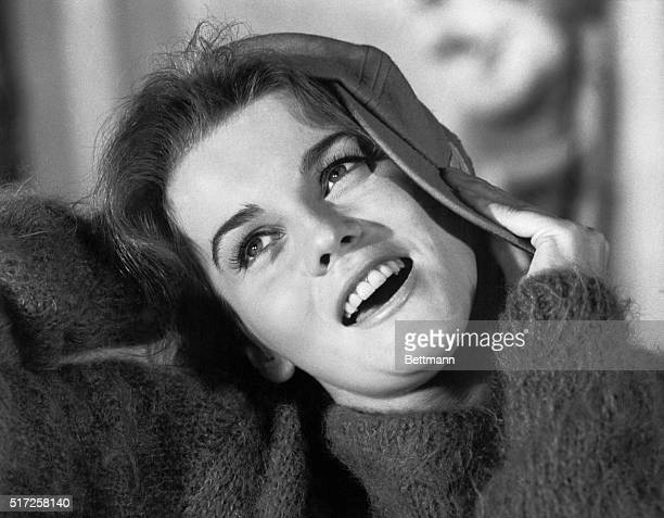 Using a baseball cap as a comic prop AnnMargret ends the song on a humorous note It just goes to prove that the Swedish glamour girl cannot look like...