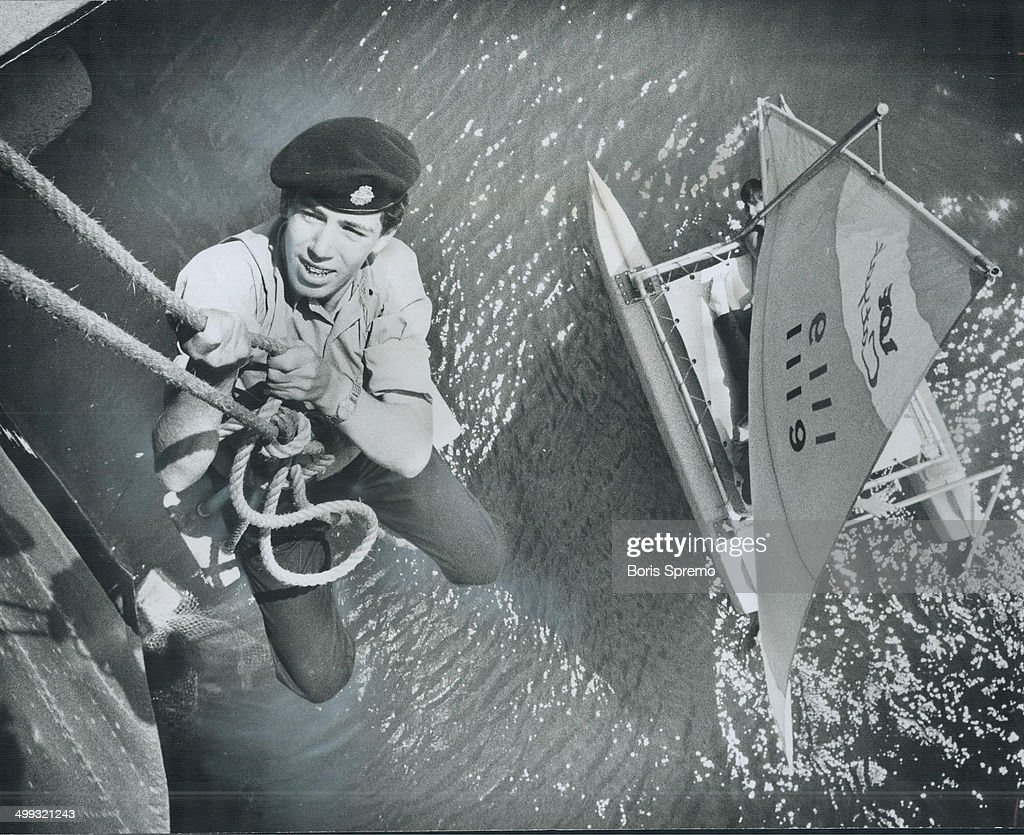 Using a bosun's chair; Sea Cadet David Eadie goes over the side of the destroyer HMCS Haida; moored ... : News Photo