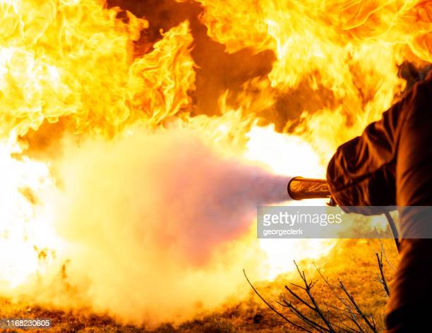 using a carbon dioxide fire extinguisher - firefighter stock pictures, royalty-free photos & images