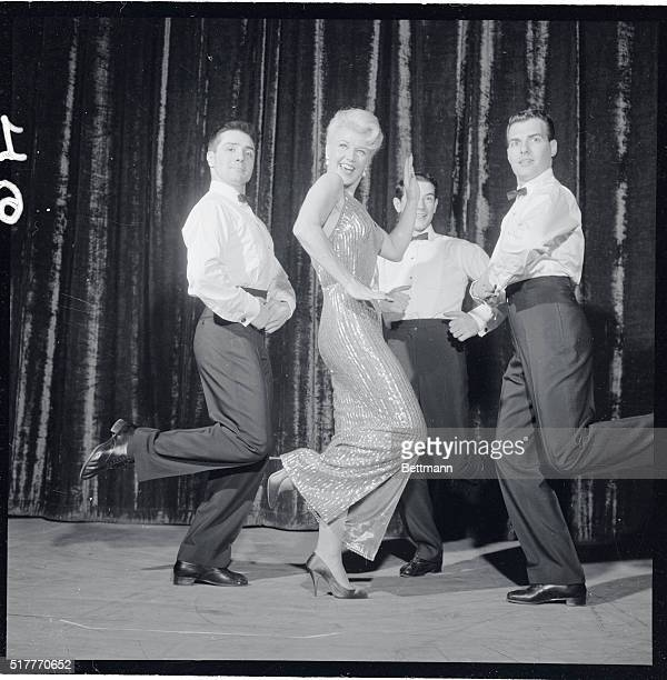Using a medley of old and new tunes, Ginger Rogers sand and danced her way across the stage of the Hotel Riviera during her first night club...