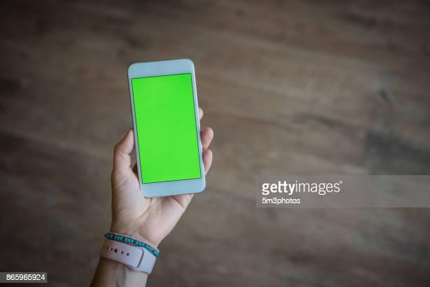 using a mobile device - chroma key foto e immagini stock