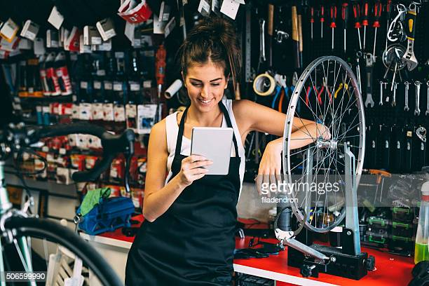 Using a tablet while fixing a bicycle