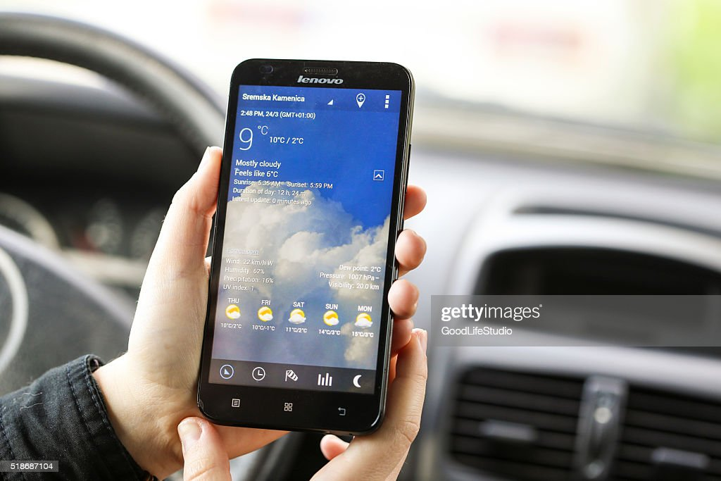 Using a weather app : Stock Photo