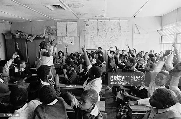 Using Afrikaans as the language of instruction a black teacher gives a history lesson on the arrival of the first Dutch settlers in South Africa |...