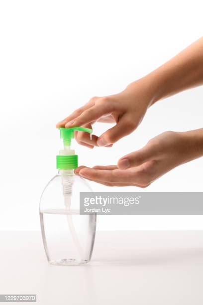 using alcohol sanitizer clean hand - pump dress shoe stock pictures, royalty-free photos & images
