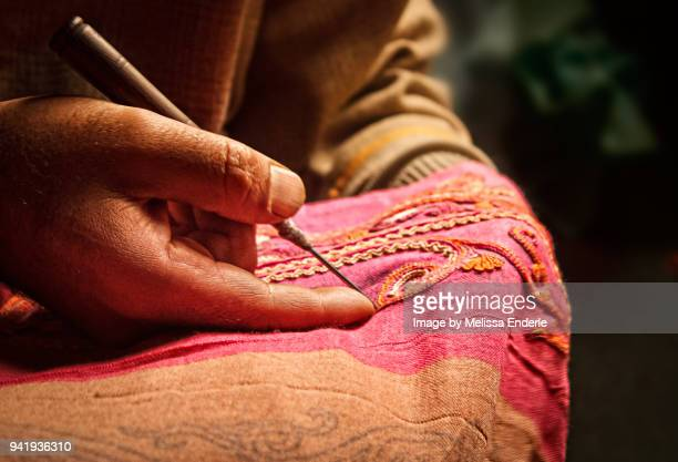 using an aar needle to make aari embroidery - jammu and kashmir stock pictures, royalty-free photos & images