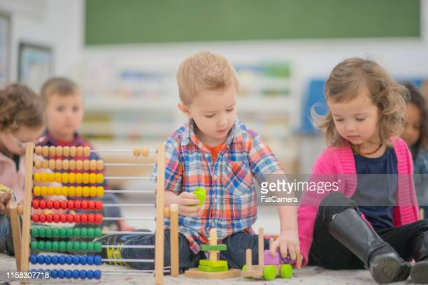 using an abacus - montessori education stock pictures, royalty-free photos & images