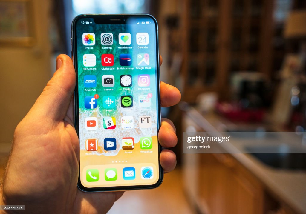 Using an iPhone X in the kitchen : Stock Photo