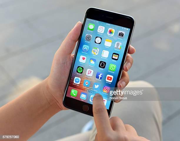 Using Apple iPhone 6 Plus in park
