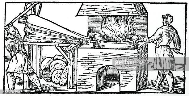 Using bellows to increase the draught in a furnace 1540 Woodcut showing a workman using bellows to increase the draught in a furnace for refining...