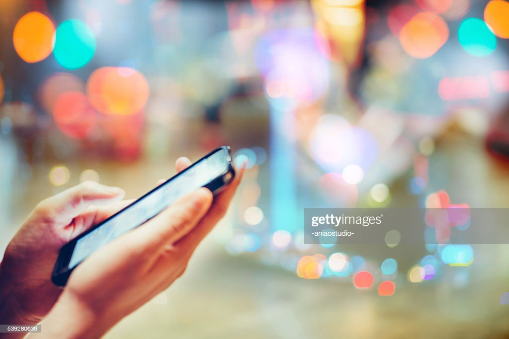 using cell phone : Stock Photo