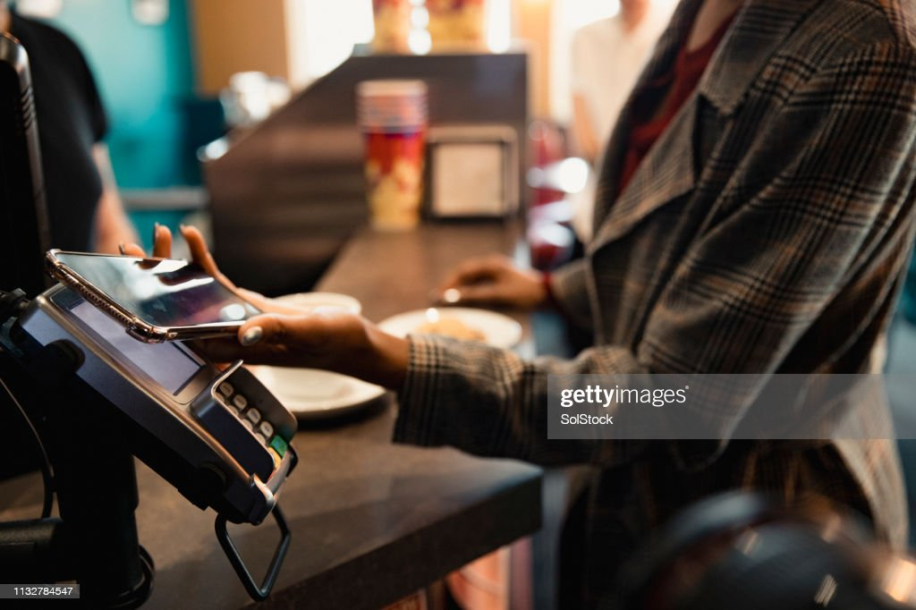 Using Contactless to Pay : Stock Photo