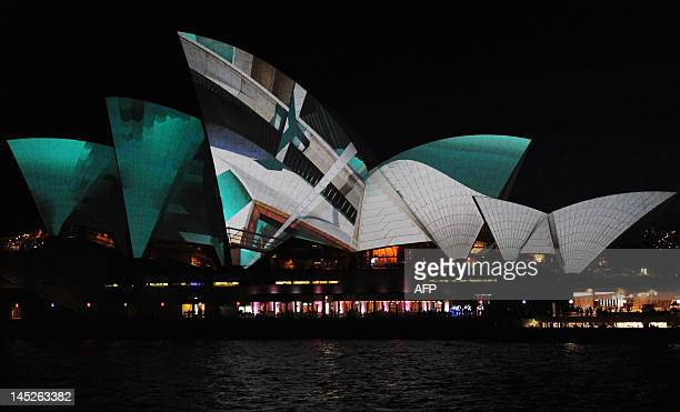Using digital 3D mapping technology images from the German design collective Urbanscreen are projected onto the sails of the Sydney Opera House...