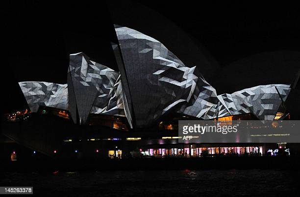 Using digital 3D mapping technology images showing the sails appearing to crumble by the German design collective Urbanscreen are projected onto the...