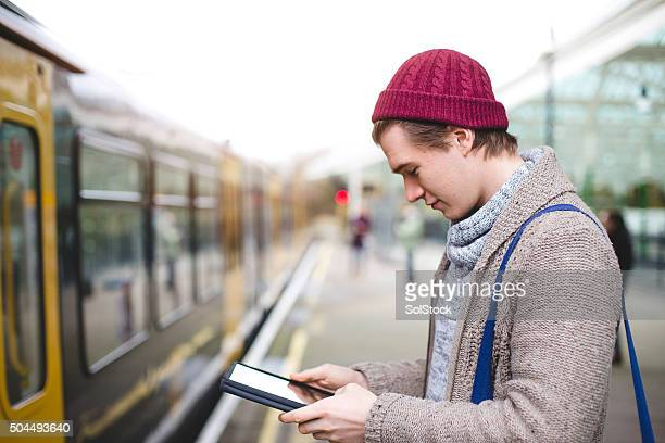 Using Digital Tablet While Waiting for the Train