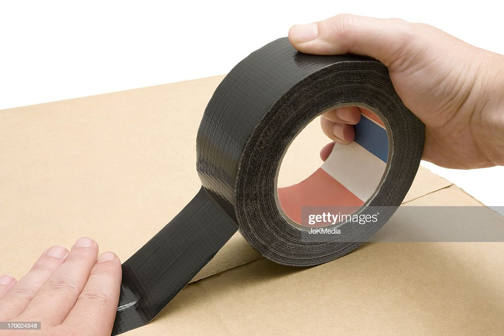 Using Duct Tape : Stock Photo