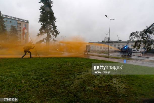 Using dyed water, police forces open fire on protestors with water cannons during the 10th Sunday March on October 11, 2020 in Minsk, Belarus. There...